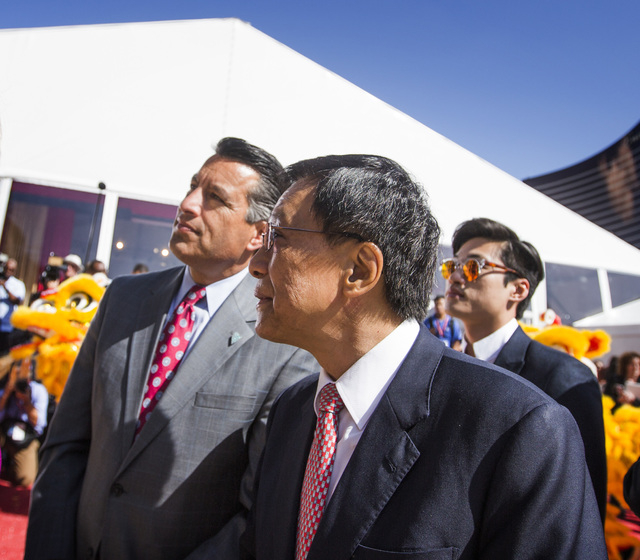 K.T. Lim, chairman, center  and CEO of Genting Group, walks with Gov. Brian Sandoval  during the groundbreaking of  the $4 billion Resorts World Las Vegas resort property, the site of the former S ...