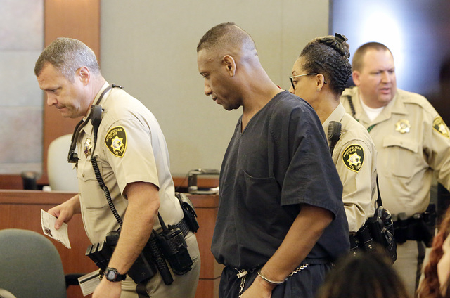 Bobby Richards, who was convicted of murdering his wife, Bronwyn Richards, is led out of the courtroom after he was sentenced to life without parole on Thursday, May 5, 2016, at the Regional Justi ...