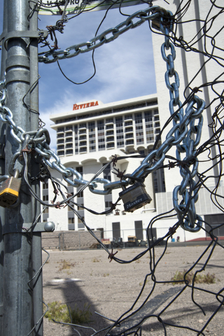 Chains and barbed wire block a hole in the fence at the site of the shuttered Riviera hotel-casino on the Las Vegas Strip on Tuesday, March 29, 2016. The casino, once demolished, will make way for ...