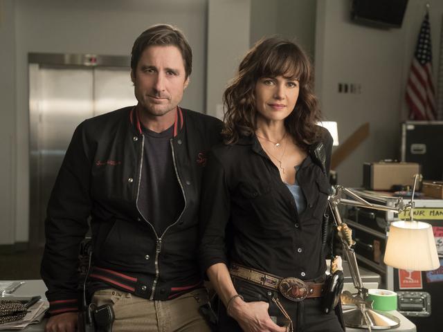 """Luke Wilson and Carla Gugino work in """"Roadies."""" (Katie Yu/Showtime)"""