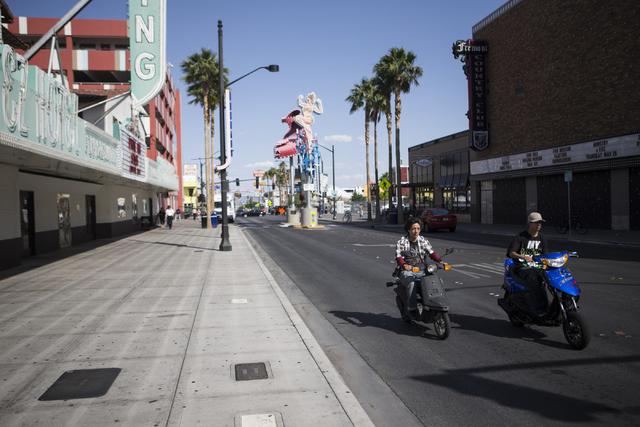 Scooter drivers ride near Fremont Street and 6th Street on Tuesday, May 24, 2016, in Las Vegas. (Erik Verduzco/Las Vegas Review-Journal Follow @Erik_Verduzco)