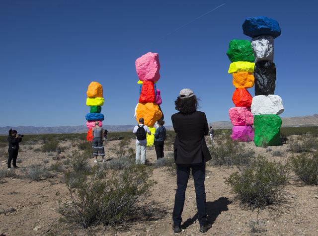 "David B. Walker, executive director of Reno's Nevada Museum of Art, looks eastward towards ""Seven Magic Mountains"" project during a Monday press preview near the Jean dry lake bed. Benjamin Hager/ ..."