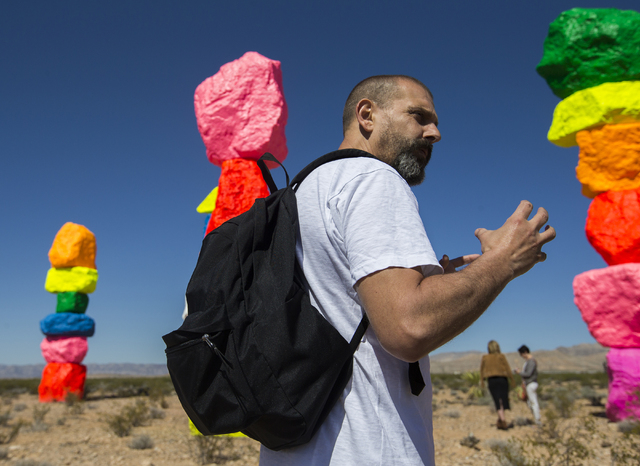 """Swiss artist Ugo Rondinone's """"Seven Magic Mountains"""" contrasts muted desert colors with the fluorescent hues covering stacked boulders of Nevada limestone. Benjamin Hager/Las Vegas Review-Journal"""
