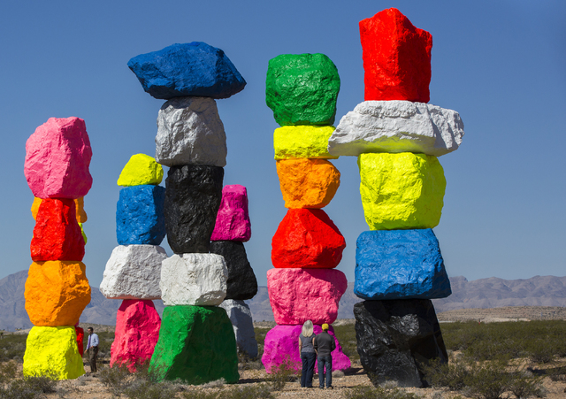 "Jill and Jim Saize, right, of Moreno Valley, Calif., tour ""Seven Magic Mountains"" Monday on their way home. ""I'm kind of a nerd for roadside adventures,"" says Jill Saiz. ""This made our drive a lot ..."