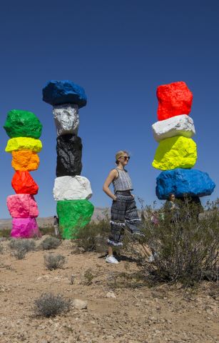 "Art Production Fund staff member Casey Fremont walks through the ""Seven Magic Mountains"" art project near Jean Dry Lake. APF produced the project along with Reno's Nevada Museum of Art. Benjamin H ..."