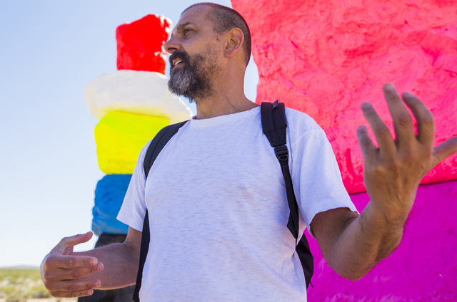 """Swiss artist Ugo Rondinone, creator of the """"Seven Magic Mountains"""" art project in the Jean dry lake bed, discusses his vision for the installation during Monday's press preview. Benjamin Hager/Las ..."""