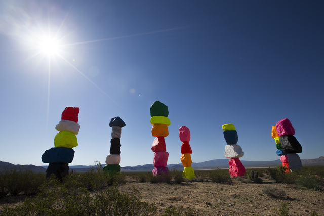 """The fluorescent colors of """"Seven Magic Mountains"""" stand out against the desert sky and the muted colors of the Jean dry lake bed. Benjamin Hager/Las Vegas Review-Journal"""