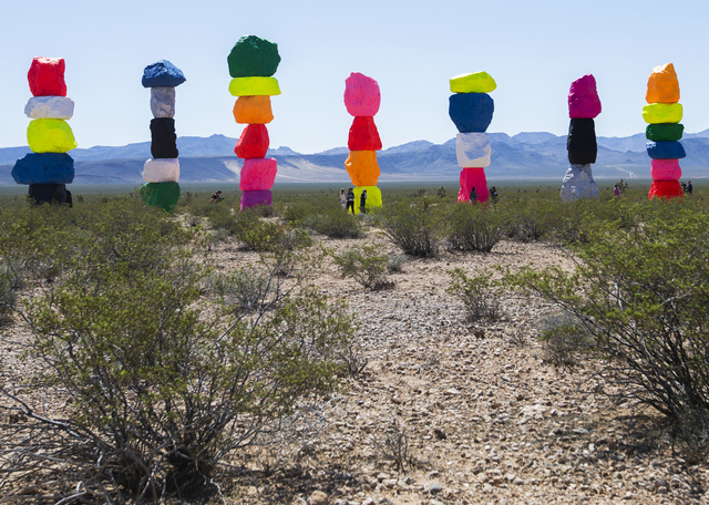 """The fluorescent colors of Swiss artist Ugo Rondinone's """"Seven Magic Mountains,"""" loacted between Sloan and Jean, stand out against the surrounding desert terrain. Benjamin Hager/Las Vegas Review-Jo ..."""