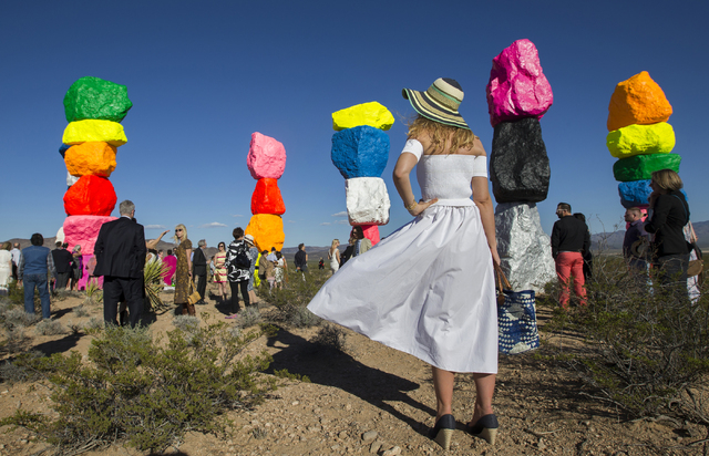 """Merlies Verhoeven, right, admires the newly unveiled Seven Magic Mountains art project during the ribbon cutting ceremony, Monday, May 9, 2016, near Jean Dry Lake, Nevada. """"I'd seen it being worke ..."""