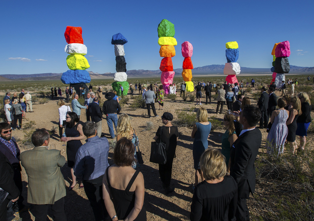 Over 200 people from around the country attended the ribbon cutting ceremony for the Seven Magic Mountains art project, Monday, May 9, 2016, near Jean Dry Lake, Nevada. The project is the work of  ...