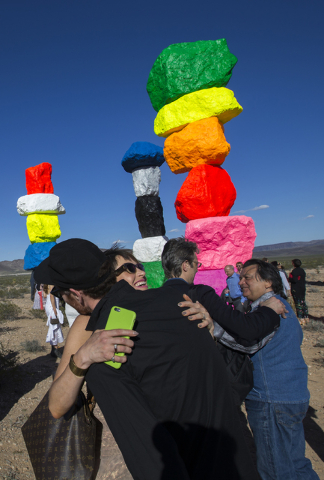Amanda Horn, director of communications for the Nevada Museum of Art, greets guests during the ribbon cutting ceremony for the Seven Magic Mountains art project, Monday, May 9, 2016, near Jean Dry ...