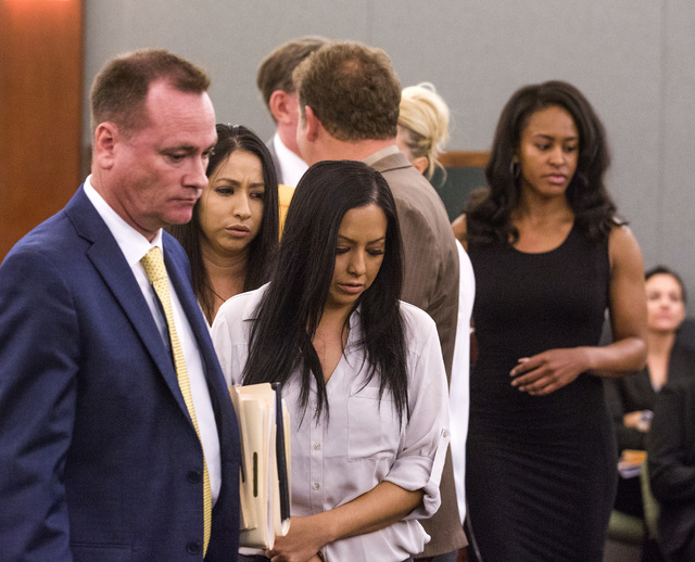 Female defendants Diana Giraldo, left, Chris Giraldo, Cyndi Sellers and Amy Rohr, in background, charged in credit card fraud and conspiracy, leave the courtroom after  appearing in court at the R ...