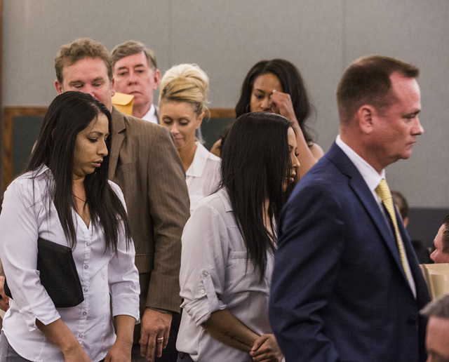 Female defendants Diana Giraldo, left, Amy Rohr, Chris Giraldo and Cyndi Sellers, background, charged in credit card fraud and conspiracy, were in court at the Regional Justice Center on Monday, M ...