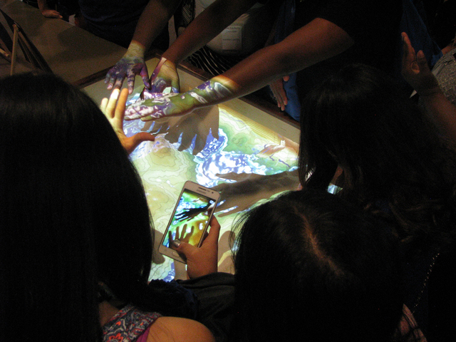 High school students on a tour of Nevada State College, 1125 Nevada State Drive, experiment with an augmented reality sandbox April 22, 2016. F. Andrew Taylor/View