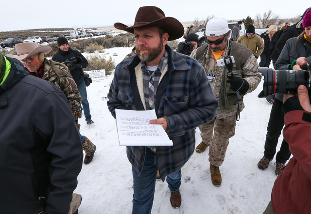 Ammon Bundy, center, prepares to speak as he is followed by conservative radio host Pete Santilli at the Malheur National Wildlife Refuge headquarters, occupied by anti-government protesters, near ...