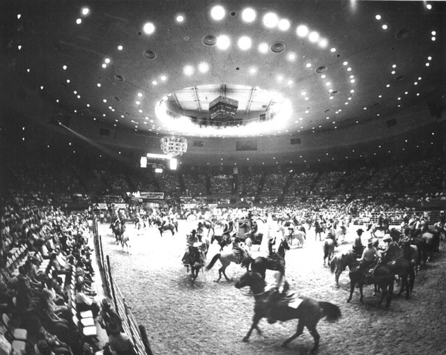 "Original caption, 1982: ""Grand entry prior to the start of the rodeo in the convention center (in Las Vegas)."""