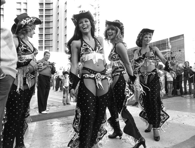 "Original caption, 1976: ""Showgirls dressed as cowboys on hand to meet the Amtrack train in celebrations kicking off Helldorado."" (Scott Henry/Las Vegas Review-Journal)"
