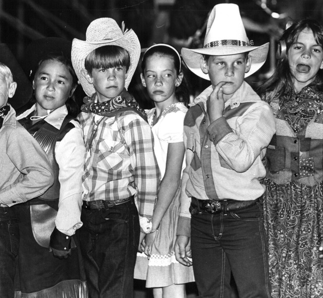 "Original caption, date unknown: ""Dressed in Western clothing, 1st and 2nd graders from Helen Marie Smith Elem. School prepare to square dance."" (Review-Journal file)"