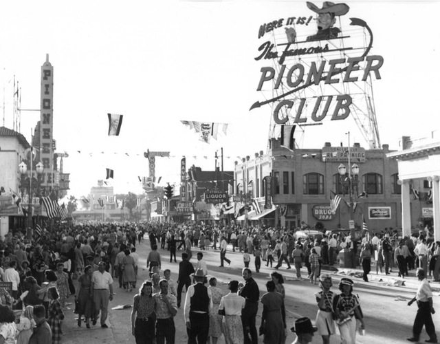 The Pioneer Club in downtown Las Vegas is seen in the background of a Helldorado Days celebration in 1963. (C. Segerblom Photography)