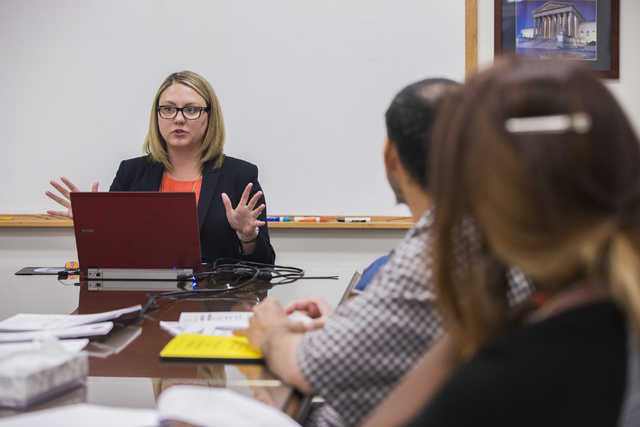 "Kendra Jepsen, a law clerk with Equal Justice Works, leads a records sealing class at Clark County Law Library, Monday, April 25, 2016, in Las Vegas. ""We see people all the time who are affected b ..."