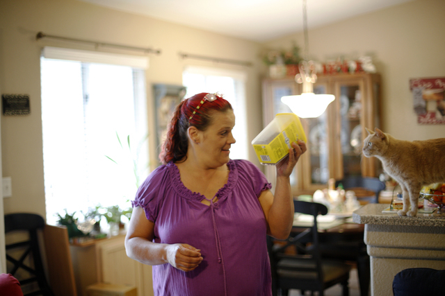 Cheryl Culpepper shakes treats to call all four of the family's cats to her at their home in Henderson, Thursday, April 28, 2016. Culpepper, a former drug addict, is using Nevada Legal Services to ...