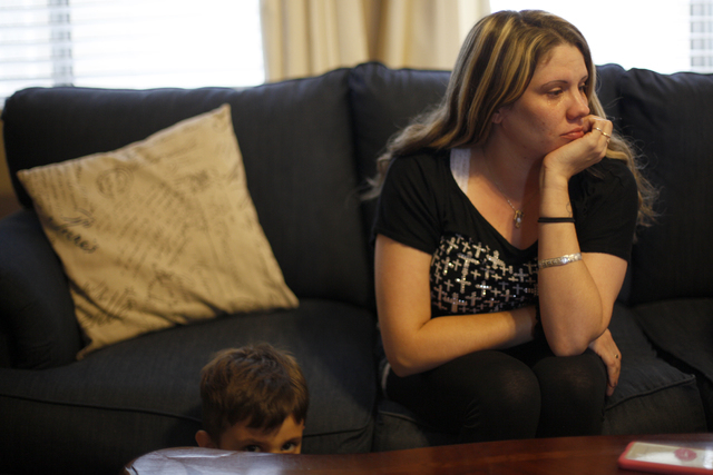 Kristen Akana, right, a friend of Cheryl Culpepper, listens with her son Brian Akana as Culpepper talks about her past at her family's home in Henderson, Thursday, April 28, 2016. Culpepper, a for ...