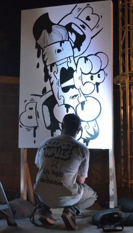 Artist Sam Canales works on a piece during the Secret Walls Las Vegas competition at Place on 7th at 115 7th Street in Las Vegas on Wednesday, May 25, 2016. Bill Hughes/Las Vegas Review-Journal