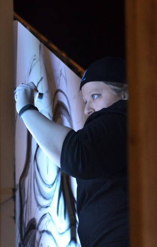 Artist Jeannette Hall works on a piece during the Secret Walls Las Vegas competition at Place on 7th at 115 7th Street in Las Vegas on Wednesday, May 25, 2016. Bill Hughes/Las Vegas Review-Journal
