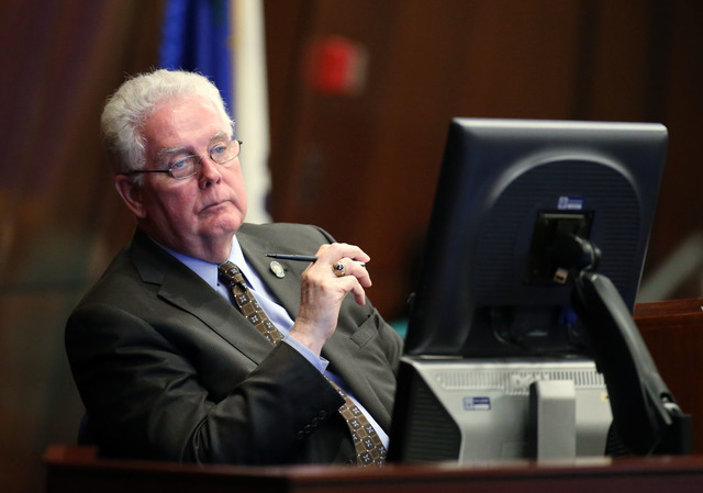 Nevada Assembly Speaker John Hambrick, R-Las Vegas, listens to Assembly floor discussion of the proposed live entertainment tax in the final hours of the session at the Legislative Building in Car ...