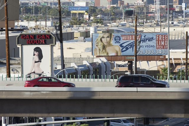 Signage for strip clubs is shown on South Industrial Road in Las Vegas Sept. 4, 2015. (View file photo)