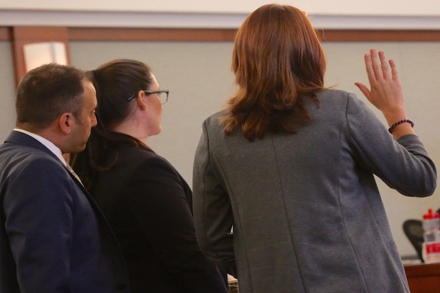 Sex traffic victim Is sworn in before making a victim statement during the sentencing of pimp Robert Sharpe. On the left is prosecutors Sam Martinez, left, and Liz Mercer. (Jeff Scheid/Las Vegas R ...