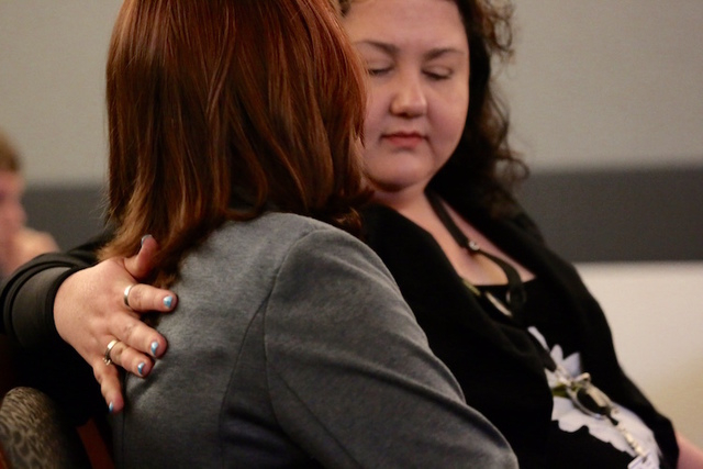Victims advocate Magann Jordan, right, places her arm around a sex traffic victim after she made a victim statement during the sentencing of pimp Robert Sharpe. (Jeff Scheid/Las Vegas Review-Journal)