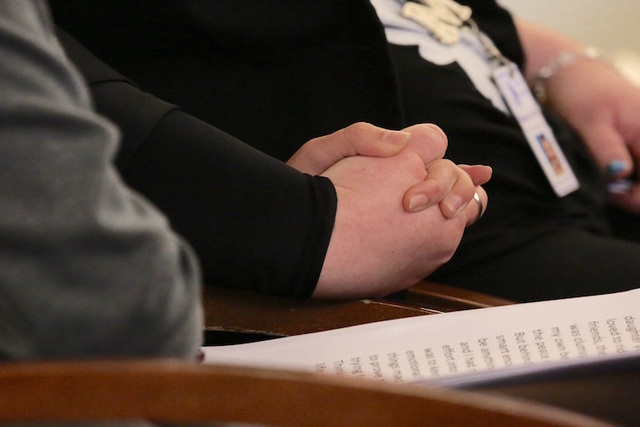 Victims advocate Magann Jordan, right, holds hands with a sex traffic victim after she made a victim statement during the sentencing of pimp Robert Sharpe. (Jeff Scheid/Las Vegas Review-Journal)
