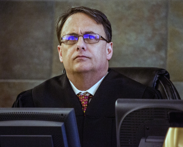 District Judge Richard Scotti listens to attorneys during the sentencing of Robert Sharpe, a pimp convicted of beating a woman and leaving her nearly dead, at Regional Justice Center on Tuesday, M ...