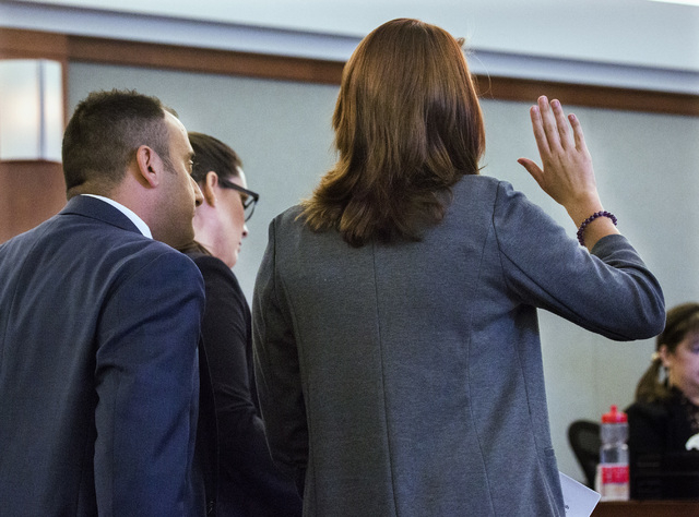 Sex traffic victim is sworn in before making a victim statement during the sentencing of pimp Robert Sharpe at Regional Justice Center on Tuesday, May 17, 2016. On the left is prosecutors Sam Mart ...