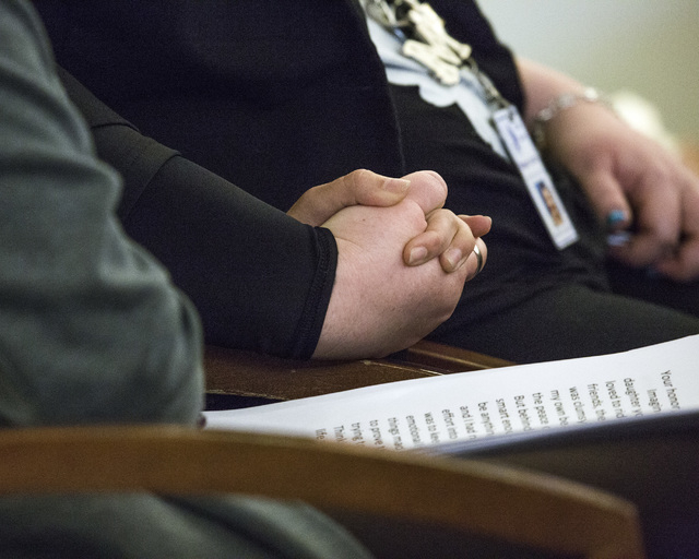 Victims advocate Magann Jordan, right, holds hands with a sex traffic victim after she made a victim statement during the sentencing of pimp Robert Sharpe on Tuesday, May 17, 2016.  Jeff Scheid/La ...