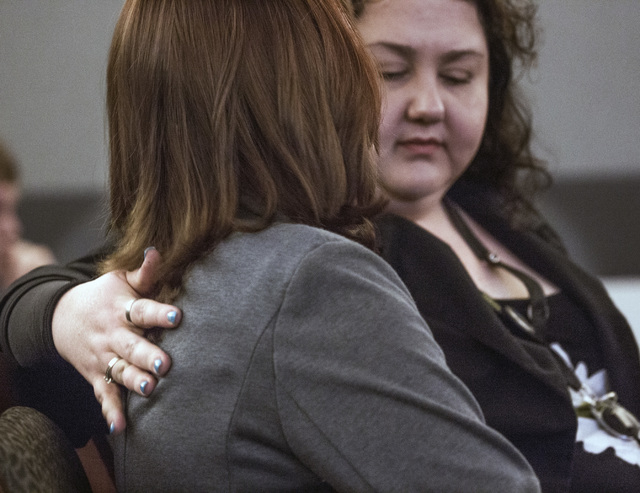 Victims advocate Magann Jordan, right, puts her arm around a sex traffic victim after she made a victim statement during the sentencing of pimp Robert Sharpe on Tuesday, May 17, 2016.  Jeff Scheid ...