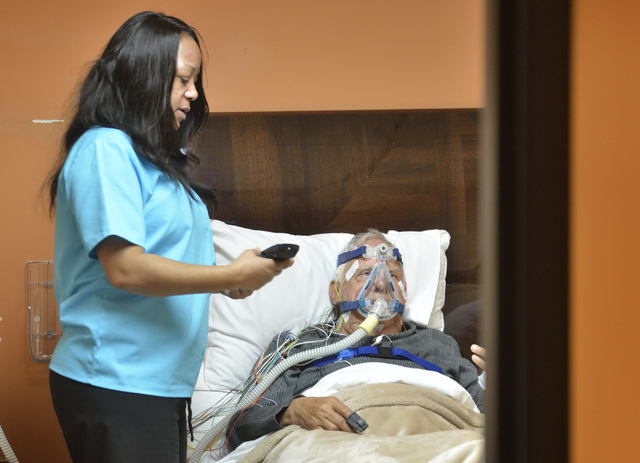 Sleep technician Kimberly Poindexter, left, prepares Ron Moroni for a sleep study at the Sleep Center of Nevada in the Red Rock Medical Center at 5701 W. Charleston Blvd. in Las Vegas on Thursday, ...