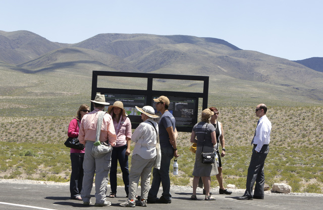 Attendees gathered at the site where the BLM dedicated the first paved access road to Sloan Canyon National Conservation Area and other visitor amenities on Thursday, May 19, 2016. Bizuayehu Tesfa ...