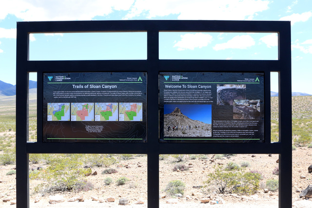Maps of trails of Sloan Canyon are posted at Sloan Canyon National Conservation Area on Thursday, May 19, 2016. The BLM Thursday dedicated the first paved access to the area and other visitor amen ...