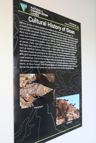 A poster is posted at Sloan Canyon National Conservation's temporary Visitors Center on Thursday, May 19, 2016. The BLM Thursday dedicated the first paved access to the area and other visitor amen ...