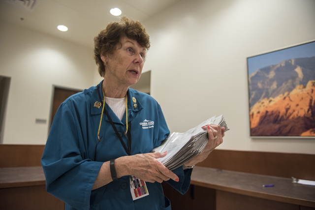 Volunteer Rita Palovchak prepares to drop off the daily newspaper at different departments at Summerlin Hospital May 6, 2016. Martin S. Fuentes/View