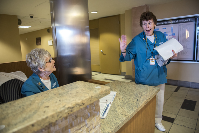 A volunteer for 17 years, Rita Palovchak, right, greets fellow volunteer Ginny Campagna at Summerlin Hospital May 6, 2016. Martin S. Fuentes/View