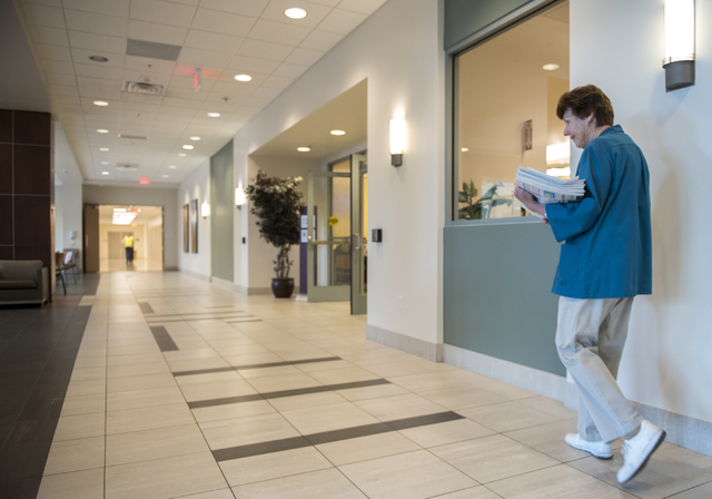 Volunteer Rita Palovchak drops off newspapers during her daily rounds at Summerlin Hospital, 657 N. Town Center Drive, May 6, 2016. Martin S. Fuentes/View