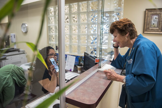 Volunteer Rita Palovchak, right, greets Gemma Henderson during her round of dropping off newspapers at Summerlin Hospital May 6, 2016. Martin S. Fuentes/View