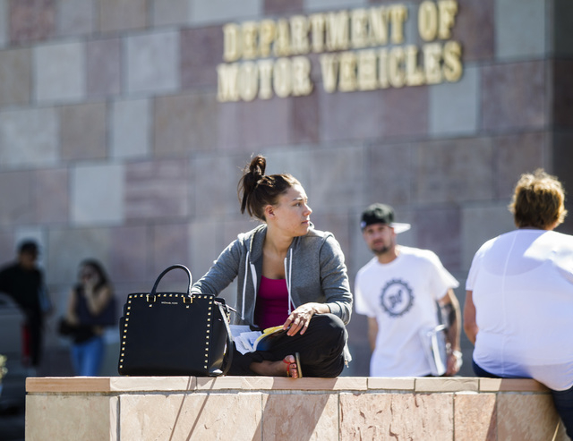 UNLV student Allyson Faiman sits outside the Nevada Department of Motor Vehicles Henderson office,1399 American Pacific Drive, on Monday, March 9,2015.  (Jeff Scheid/Las Vegas Review-Journal)