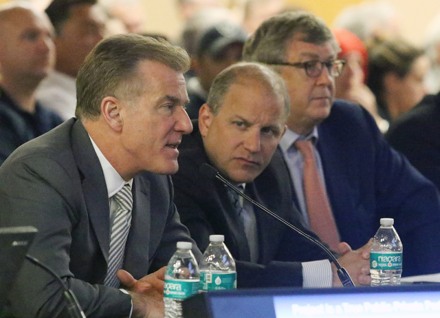 Rob Goldstein, left, chief operating officer of Las Vegas Sands Corporation, speaks near Marc Badain, president of the Oakland Raiders, center, and Greg Carey of Goldman Sachs at a meeting of the  ...