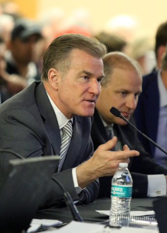 Rob Goldstein, left, chief operating officer of Las Vegas Sands Corporation, speaks near Marc Badain, president of the Oakland Raiders, at a meeting of the Southern Nevada Tourism Infrastructure C ...