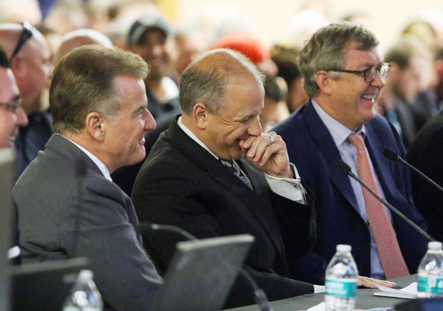 Marc Badain, president of the Oakland Raiders, center, shares a laugh with Rob Goldstein, left, chief operating officer of Las Vegas Sands Corporation, and Greg Carey of Goldman Sachs at a meeting ...