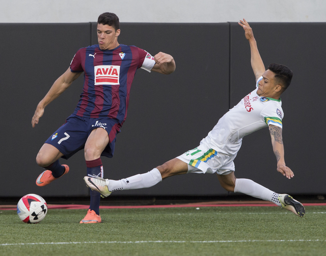 SD Eibar's Ander Capa (7) fights for a ball with New York Cosmos' David Diosa (21) during a friendly between the New York Cosmos and SD Eibar, Wednesday, May 25, 2016, at Sam Boyd Stadium in Las V ...